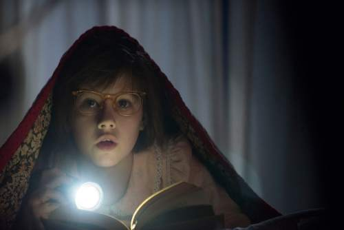 """This image released by Disney shows Ruby Barnhill in a scene from""""The BFG."""" (Doane Gregory/Disney via AP)"""