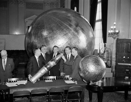 Aluminum foil balloons, one 12 feet in diameter, and a model of the rocket nose section designed to carry them into outer space in collapsed form, form appropriate subject matter for conversation between these five witnesses at the House Space Committee, Washington, D.C., April 22, 1958. Left to right: Dr. Hugh L. Dryden, director, National Advisory Committee on Aeronautics; Dr. Arthur Kantrowitz, director, Avco Research Laboratory, Everett, Mass.; Dr. Simon Ramo, Ramo-Woolridge Corp., Los Angeles; Krafft A. Ehricke, Convair expert, San Diego; and Allen P. Donovon, Ramo-Worldwide Corp., Los Angeles. (AP Photo/Harvey Georges)