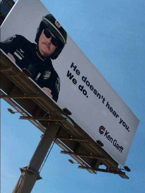 Courtesy  |  Matt Michela, KUTV  Ken Garff said it is removing a billboard advertisement that has been seen as anti-police and sparked outrage on social media.