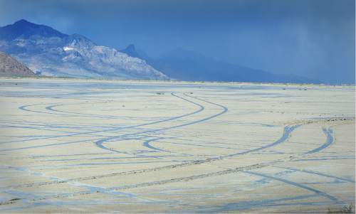 Scott Sommerdorf   |  The Salt Lake Tribune   Tire tracks left by unknown drivers were not hard to see on the slat flats on Friday, May 27, 2016. despite the numerous signs warning motorists to stay off the salt flats near the Bonneville Speedway..