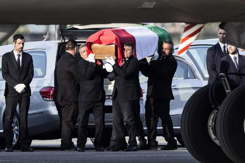 The coffin of one of the nine Italian victims, who were killed in the July 1 attack in the Bangladeshi capital of Dhaka, is shoulder carried at Rome's Ciampino military airport. The brutality of the attack, the worst convulsion of violence yet in the recent series of deadly attacks to hit Bangladesh, has stunned the traditionally moderate Muslim nation and raised global concerns about whether it can cope with the increasingly strident Islamist militants. (Angelo Carconi/ANSA Via AP)