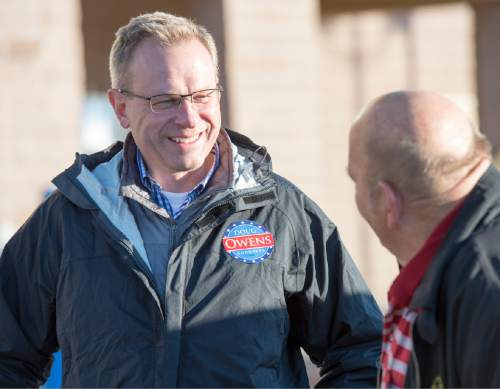 Rick Egan  |  The Salt Lake Tribune  Doug Owens chats with Leroy Tharp as he campaigns in a shopping center in West Jordan, Monday, November 3, 2014