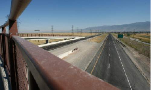 Steve Griffin  |  The Salt Lake Tribune  The Legacy Parkway can be seen heading north from the pedestrian bridge across the road in Davis County Aug. 29, 2008.