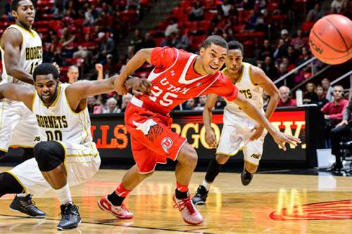 Trent Nelson  |  The Salt Lake Tribune Alabama State Hornets center Wendell Lewis (00) holds onto Utah Utes guard Kenneth Ogbe (25) as the University of Utah Utes host the Alabama State Hornets, college basketball at the Huntsman Center in Salt Lake City, Saturday November 29, 2014.