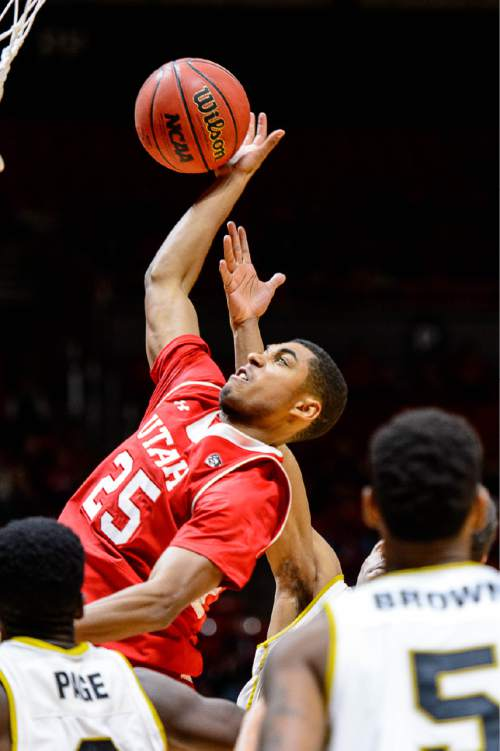 Trent Nelson  |  The Salt Lake Tribune Utah Utes guard Kenneth Ogbe (25) pulls down a rebound as the University of Utah Utes host the Alabama State Hornets, college basketball at the Huntsman Center in Salt Lake City, Saturday November 29, 2014.