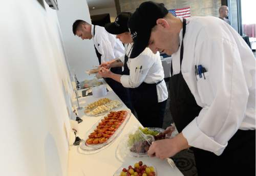 Francisco Kjolseth | The Salt Lake Tribune Jarrett Lichtenstein, left, sous chef Dustin Dash, middle, and Brad Smythe, plate appetizers for a cockatil party hosted by Culinary Command,  a training program for veterans and active military that recently launched in Utah.