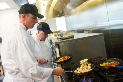 Chris Detrick  |  The Salt Lake Tribune Kurt Farnes, Air Force, front, and Brad Smythe, Army, cook during the second day of Culinary Command, a training program for veterans and active military. Wednesday June 1, 2016.
