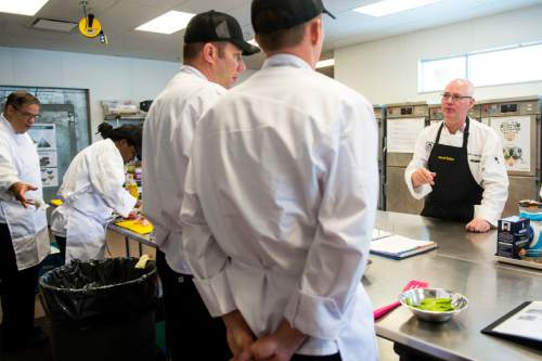 Chris Detrick  |  The Salt Lake Tribune Culinary Command Executive Chef David Robinson talks with Jarrett Lichtenstein, a veteran of the Marines,during the second day of training.  Wednesday June 1, 2016.