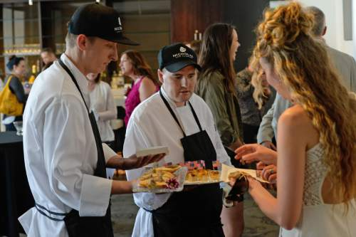 Francisco Kjolseth | The Salt Lake Tribune Kurt Farnes, left, and Brad Smythe serve guests appetizers as part of the Culinary Command, a free training program for veterans and active military that recently launched in Utah.
