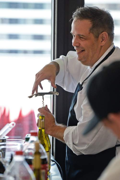 Francisco Kjolseth | The Salt Lake Tribune Cliff Hutson works the bar during a cocktail party hosted by Culinary Command, a free training program for veterans and active military.