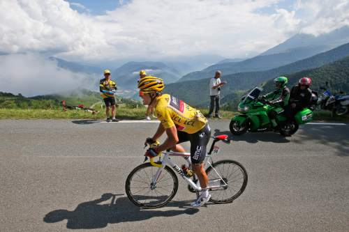 Belgium's Greg van Avermaet, wearing the overall leader's yellow jersey, climbs Aspin pass during the seventh stage of the Tour de France cycling race over 162.5 kilometers (100.7 miles) with start in L'Isle-Jourdain and finish in Lac de Payolle, France, Friday, July 8, 2016. (AP Photo/Christophe Ena)