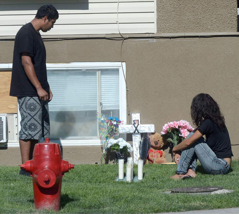 Al Hartmann  |  The Salt Lake Tribune  Friends and family mourn at a memorial Thursday July 7 for a15-year-old girl and a 16-year-old boy, believed to have been shot about 11 p.m. Wednesday outside the Mill Creek II Apartments complex near 700 West and 7800 South.
