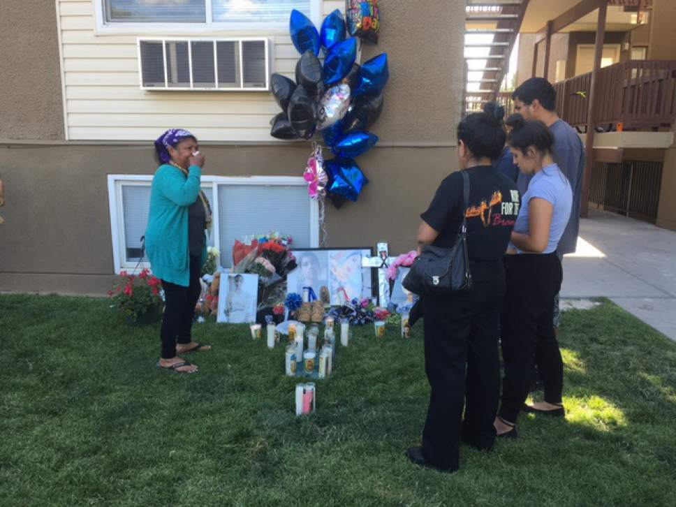 Mariah Noble  |  The Salt Lake Tribune  People morn for siblings Jose and Abril Izazaga who died Wednesday, July 6 after they were shot outside the Mill Creek II Apartments complex in Midvale, Utah.