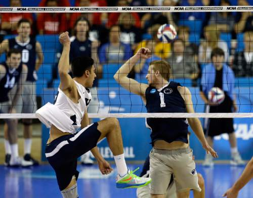 BYU's Taylor Sander reacts to a kill as Penn State's Taylor Hammond (1) misses the block in the third set of their NCAA Final Four college volleyball tournament semifinal at UCLA in Los Angeles Thursday, May 2, 2013. BYU won, 25-21, 25-16, 25-22. (AP Photo/Reed Saxon)