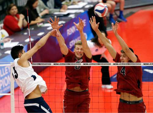 Stanford's James Shaw (8) and Conrad Kaminski (4) try to block the ball hit by BYU's Taylor Sander, left, during the first set of an NCAA men's college volleyball tournament semifinals in Chicago on Thursday, May 1, 2014. (AP Photo/Nam Y. Huh)