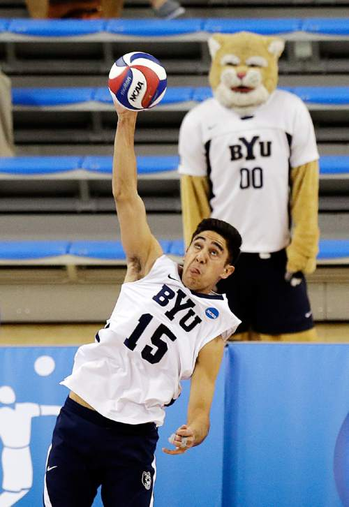 BYU's Taylor Sander (15) serves against Penn State in the first set of their NCAA Final Four college volleyball tournament semifinal in Los Angeles, Thursday, May 2, 2013. (AP Photo/Reed Saxon)
