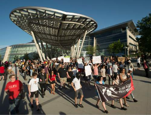 Rick Egan  |  The Salt Lake Tribune  Hundreds of protesters leave the Salt Lake City Public Safety Building square,  to march to Sam Gill's office, during an emergency protest against police brutality to support the protests in Baton Rouge and St. Paul, Saturday, July 9, 2016.