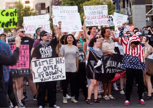 Rick Egan  |  The Salt Lake Tribune  Hundreds of protesters march from the Salt Lake City Public Safety Building square,  o march to Sim Gill's office, during an emergency protest against police brutality to support the protests in Baton Rouge and St. Paul, Saturday, July 9, 2016.