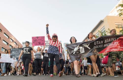 Rick Egan  |  The Salt Lake Tribune  Jacobo Funes leads a group of more than 200 protesters down State Street during an emergency protest against police brutality to support the protests in Baton Rouge and St. Paul, Saturday, July 9, 2016.