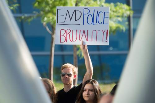 Rick Egan  |  The Salt Lake Tribune  Alex Russell holds a sign at the protest against police brutality to support the protests in Baton Rouge and St. Paul, at the Salt Lake City Public Safety Building, Saturday, July 9, 2016.