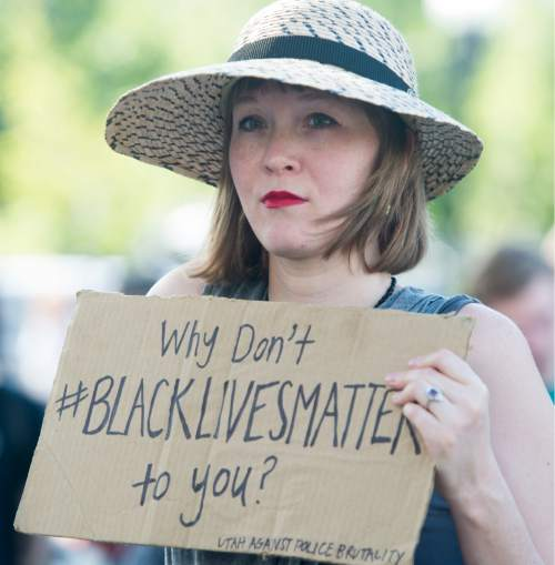 Rick Egan  |  The Salt Lake Tribune  Preslie Paur holds a sign at the protest against police brutality to support the protests in Baton Rouge and St. Paul, at the Salt Lake City Public Safety Building, Saturday, July 9, 2016.