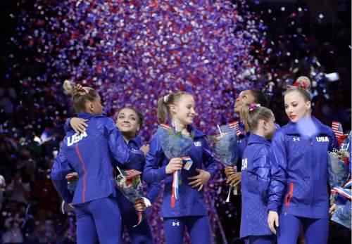 U.S. Olympic women's gymnastics team members  Ashton Locklear, from left, celebrates with Lauren Hernandez, Madison Kocian, Gabrielle Douglas, Ragan Smith and MyKayla Skinner after the women's U.S. Olympic gymnastics trials in San Jose, Calif., Sunday, July 10, 2016. (AP Photo/Gregory Bull)