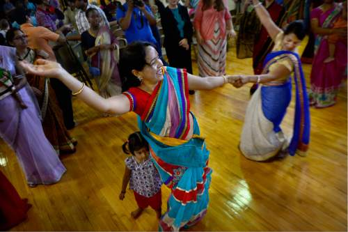 Scott Sommerdorf   |  The Salt Lake Tribune   Vinita Sharma, left, and Priya Neema dance during the Kirtan ceremony blessing the area where the new Krishna Temple designed by Vaibhavi Devi will stand in Salt Lake City, Sunday, July 10, 2016.