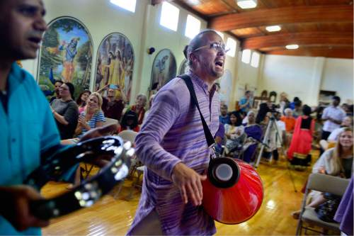 Scott Sommerdorf   |  The Salt Lake Tribune   Jai Krishna - Kirtan - playing the mridanga - during the Kirtan for the blessing of the new Krishna Temple designed by Vaibhavi Devi, who worked on the Spanish Fork Krishna Temple, Sunday, July 10, 2016.