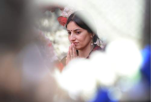 Scott Sommerdorf   |  The Salt Lake Tribune   Pakhi Misra listens and takes in the Kirtan ceremony as the are where the new Krishna Temple in Salt Lake City will stand is blessed, Sunday, July 10, 2016.