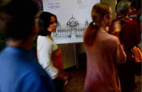 Scott Sommerdorf   |  The Salt Lake Tribune   Visitors stream past a representation of what the new  Krishna Temple in Salt Lake City. The building is designed by Vaibhavi Devi, who worked on the Spanish Fork Krishna Temple, Sunday, July 10, 2016.