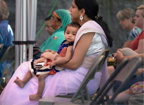 Scott Sommerdorf   |  The Salt Lake Tribune   Bhavna Raghav listens to the ceremony with her daughter as the foundation for the new Krishna Temple designed by Vaibhavi Devi, is blessed, Sunday, July 10, 2016.