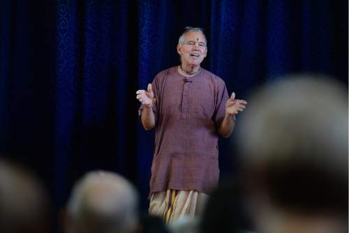 Scott Sommerdorf   |  The Salt Lake Tribune   Caru Das announces the donations that have been collected tho help build the new Krishna Temple designed by Vaibhavi Devi, that will be built in Salt Lake City, Sunday, July 10, 2016.