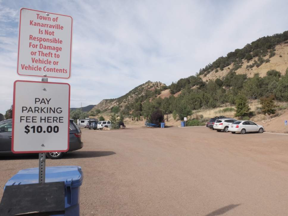 Nate Carlisle     The Salt Lake Tribune  Twenty-one cars sit in the parking lot of the Kanarraville Falls trailhead on the afternoon of July 3, 2016. The town of Kanarraville charges hikers to park at the trailhead.