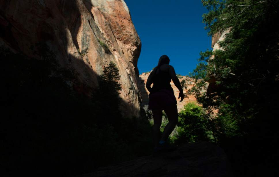 Steve Griffin / The Salt Lake Tribune  Hikers make their way to Kanarraville Falls up Kanarra Creek Canyon in Iron County. The BLM is seeking to purchase 41 acres at the canyon's mouth to better manage this area for recreational visitors, which numbered at least 40,000 last year.  Wednesday July 6, 2016.
