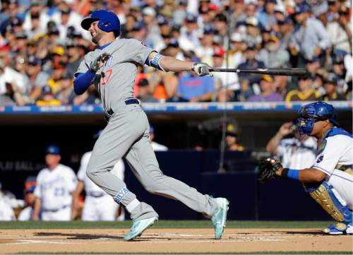 National League's Kris Bryant, of the Chicago Cubs, follows through on a solo home run during the first inning of the MLB baseball All-Star Game against the American League, Tuesday, July 12, 2016, in San Diego. (AP Photo/Gregory Bull)