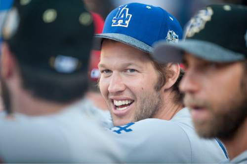 Los Angeles Dodgers' Clayton Kershaw laughs with teammates during the 2016 MLB All-Star Game at Petco Park in San Diego, Tuesday, July 12, 2016. (Kevin Sullivan/The Orange County Register via AP)