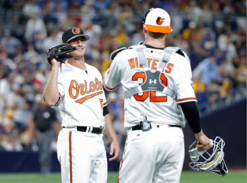American League's Zach Britton, of the Baltimore Orioles, greets American League's Matt Wieters, of the Baltimore Orioles, after the MLB baseball All-Star Game, Tuesday, July 12, 2016, in San Diego. The American League won 4-2. (AP Photo/Lenny Ignelzi)