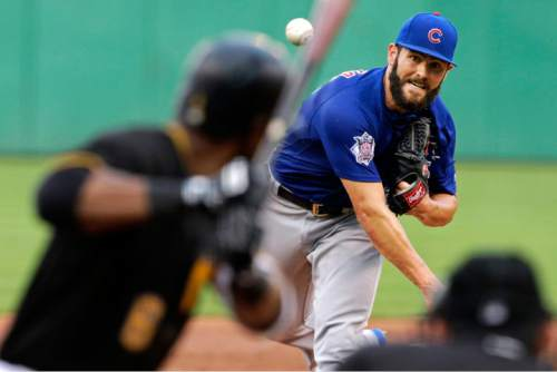 Chicago Cubs starting pitcher Jake Arrieta, right, delivers during the fourth fourth inning of a baseball game against the Pittsburgh Pirates in Pittsburgh, Friday, July 8, 2016. (AP Photo/Gene J. Puskar)