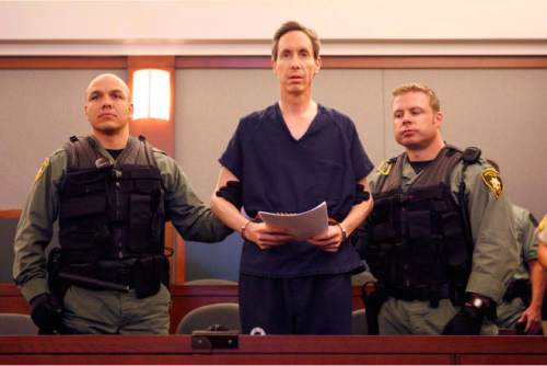 Trent Nelson  |  Tribune file photo  Handcuffed and flanked by Las Vegas Metro PD Swat officers, FLDS leader Warren Jeffs appeared before Judge James M. Bixler on August 31, 2006. Former FLDS members have sued Jeffs and a law firm which represented him since 1998.