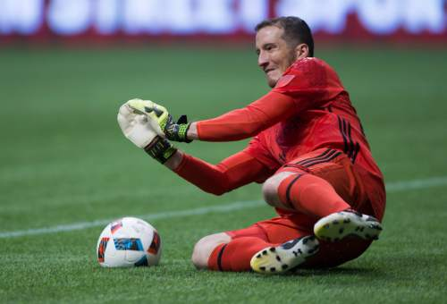 Real Salt Lake goalkeeper Jeff Attinella makes a save against the Vancouver Whitecaps during the second half of an MLS soccer match on Wednesday July 13, 2016, in Vancouver, British Columbia. (Darryl Dyck/The Canadian Press via AP)