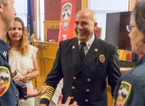 Rick Egan  |  The Salt Lake Tribune  Chief Brian Dale visits with family, friends and colleagues after being sworn in as the new Salt Lake City fire chief at City Hall on Thursday, June 4, 2015.