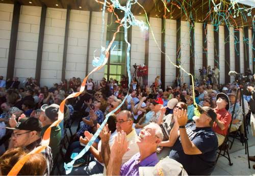 Rick Egan  |  The Salt Lake Tribune  Confetti lands on the crowd during the ribbon-cutting of the Beverley Taylor Sorenson Center for the Arts, which includes the new Southern Utah Museum of Art and two new Utah Shakespeare Festival theaters, Cedar City, Thursday, July 7, 2016.