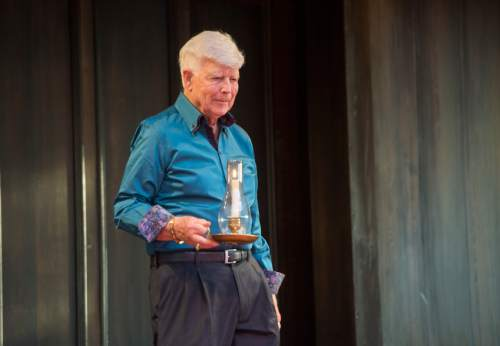 Rick Egan  |  The Salt Lake Tribune  Fred C. Adams, Utah Shakespeare Festival founder and executive producer emeritus, brings a candle onstage during the dedication of the Engelstad Shakespeare Theatre in Cedar City, Thursday, July 7, 2016.