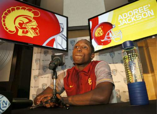 Southern California defensive back Adoree Jackson speaks at the Pac-12 NCAA college football media day in Los Angeles on Thursday, July 14, 2016. Jackson is back from a seven-month break from football while he tried to qualify for the U.S. Olympic track team, and the multi-talented athlete plans to focus primarily on playing defense this fall. (AP Photo/Reed Saxon)