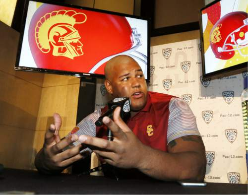 USC offensive tackle Zach Banner speaks at the Pac-12 NCAA college football media day in Los Angeles Thursday, July 14, 2016. (AP Photo/Reed Saxon)