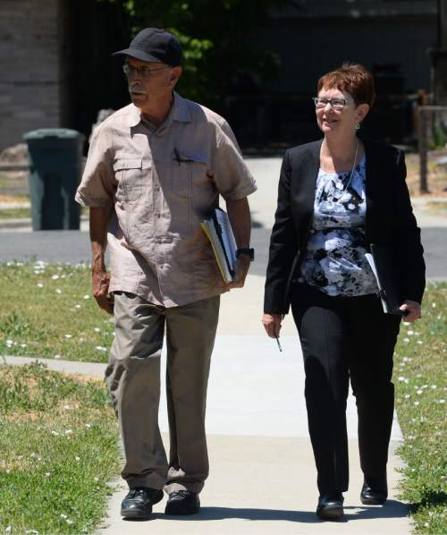 Steve Griffin / The Salt Lake Tribune  Alyson Kennedy, who is running for president on the Socialist Workers Party ticket, walks with campaigner Anthony Dutrow as she campaigns door to door near Liberty Park in Salt Lake City Thursday July 14, 2016.