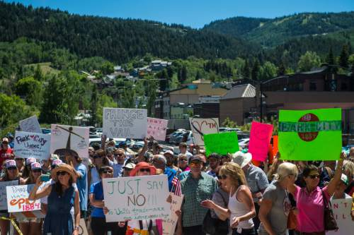 "Chris Detrick  |  The Salt Lake Tribune Protestors rally against Vail Corp outside of Park City Hall Wednesday July 13, 2016. Vail Resorts Inc. has filed for to trademark the name ""Park City."" Residents and businesses have complained and the municipality has tried to reach an agreement with Vail so that the resort company won't sue the municipality or businesses whose names include the words ""Park City."" Vail has refused to sign such a contract."