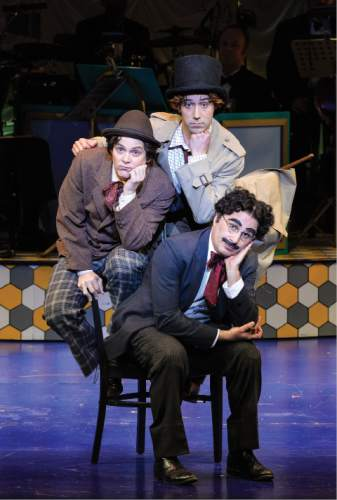 Karl Hugh     Copyright Utah Shakespeare Festival 2016  Tasso Feldman (top) as Harpo (Silent Red), Jim Paulos as Chico (Willie Wony Diddydony), and John Plumpis as Mr. Hammer (Groucho) in the Utah Shakespeare Festivalís 2016 production of The Cocoanuts.