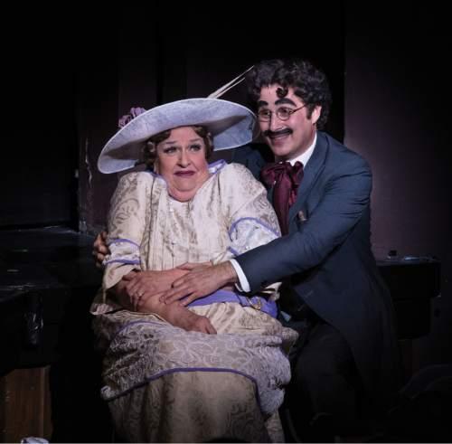 Karl Hugh     Copyright Utah Shakespeare Festival 2016  Kathleen M Brady (left) as Mrs. Potter and John Plumpis as Mr. Hammer (Harpo) in the Utah Shakespeare Festival's 2016 production of The Cocoanuts.