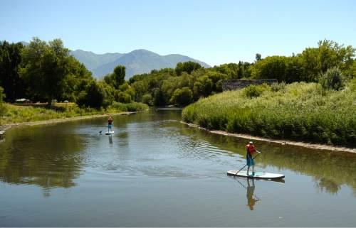 Rick Egan  |  The Salt Lake Tribune  Trenton DeLong 12, and Colton DeLong 14, Mesa. Arizona, paddle down the Provo River, at Utah Lake State Park, Thursday, July 14, 2016.